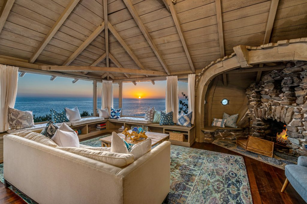 Interior Of The Ark In Laguna Beach, Ca With Fireplace And Ocean Views At Sunset